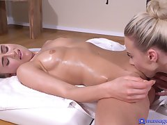A hot Lez girl scissors with a busty massuse in rub-down the palpate room