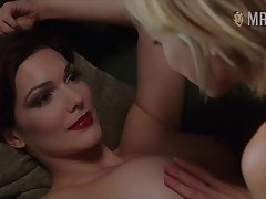 Busty goddess Laura Harring enjoying some steamy sapphic fun on the couch